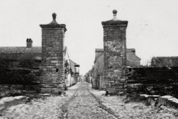 black and white historic image of the city gates in St. Augustine, FL